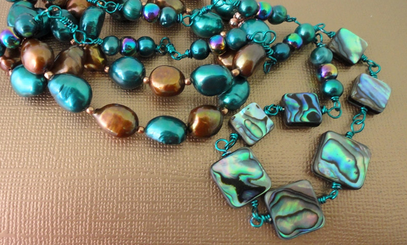 Lustrous Mother of Pearl, vibrant Teal Pearl and Haematite necklace